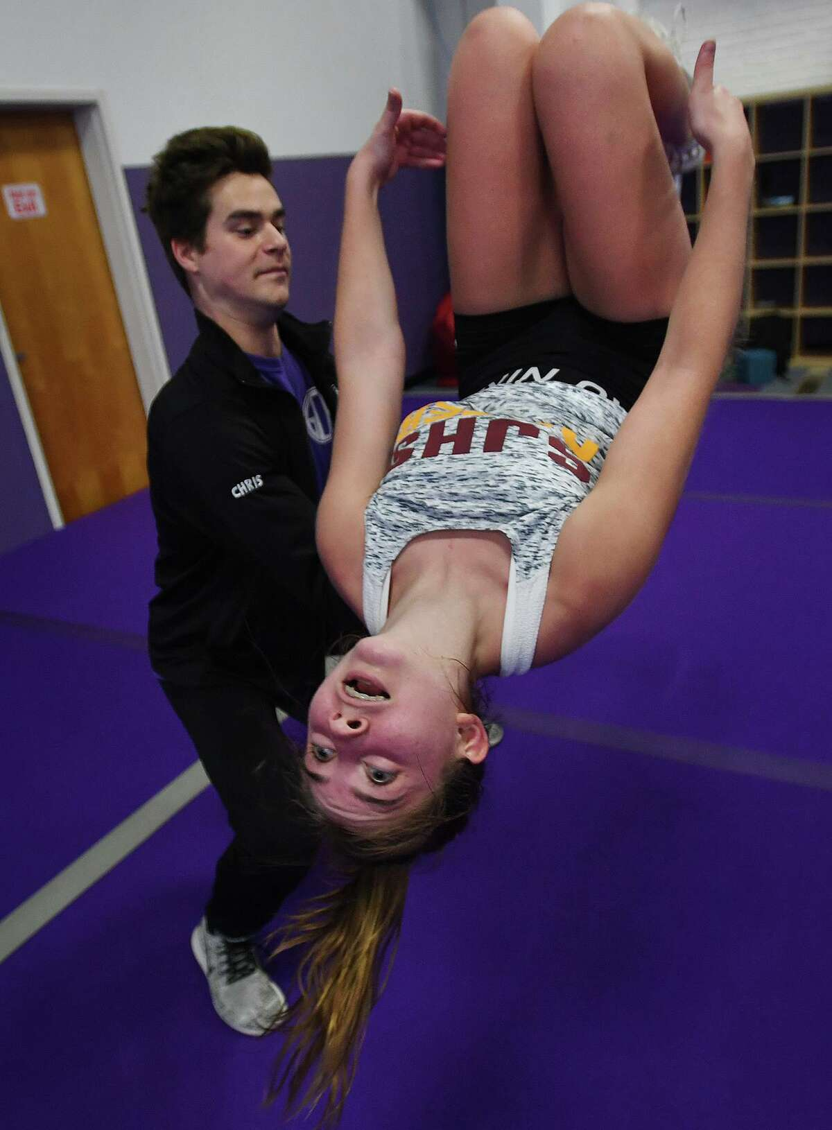 Hope Wenzel, 13, of Easton, practices back flips with the help of coach Chris Polley, of Norwalk, at the Gymnastics and Cheerleading Academy of CT in the SportsPlex complex at 85 Mill Plain Road in Fairfield, Conn. on Tuesday, September 17, 2019.
