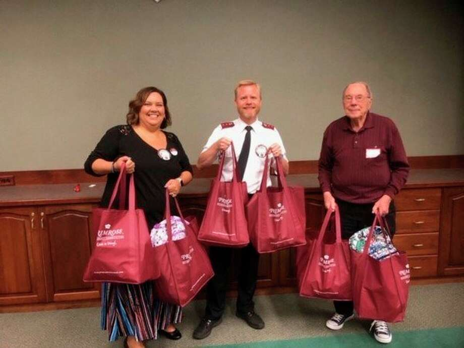 From left, Kiwassee members Crystalee Cook and Midland Salvation Army Captain Brian Goodwill, and Primrose resident Hal Purves. Not pictured: Primrose staff Pam O'Neil and Kiwassee member and Longview Early Childhood Center Director Kim Clark. (Photo provided)