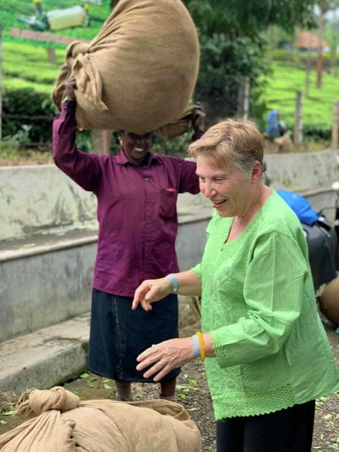 Mid Michigan College President Christine Hammond learns about tea processing at the Connemara Tea Plantation and Factory. (Photo provided)