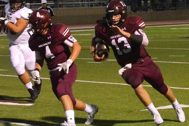 Abernathy quarterback Bryson Daily follows the block of Tanner Timms to take a 26-yard run in for a touchdown during the second quarter of a non-district football game against Post on Friday night at Antelope Stadium.
