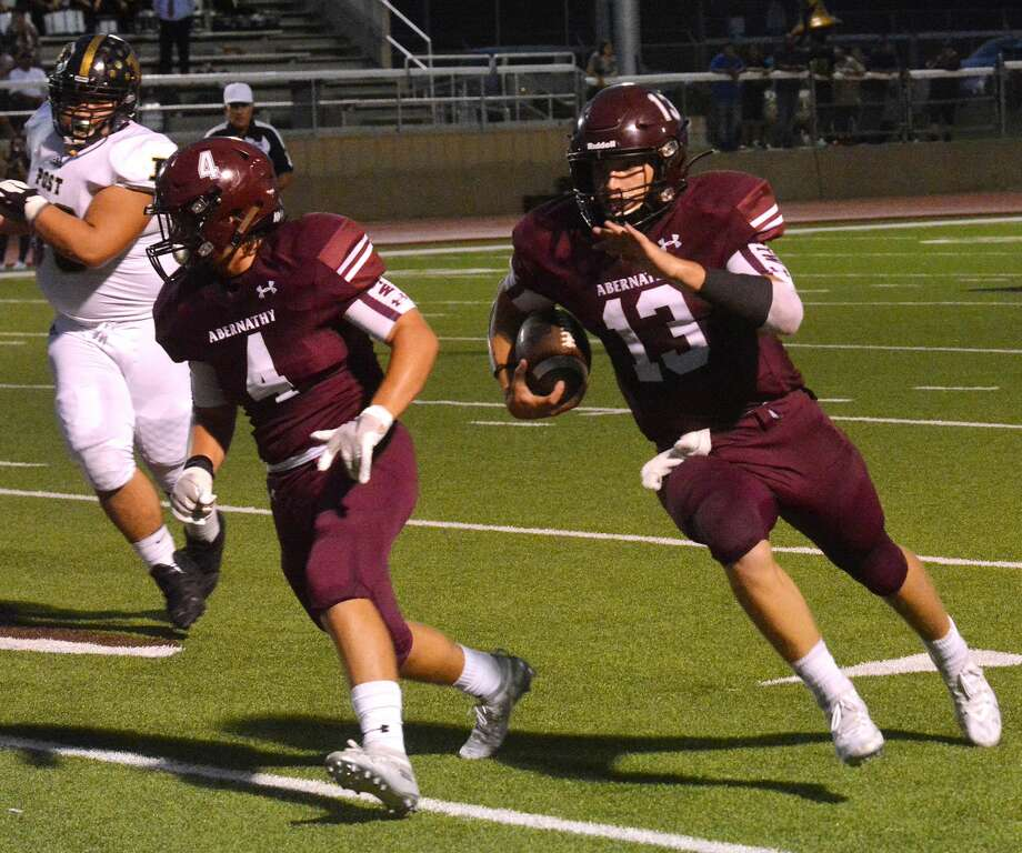 Abernathy quarterback Bryson Daily follows the block of Tanner Timms to take a 26-yard run in for a touchdown during the second quarter of a non-district football game against Post on Friday night at Antelope Stadium. Photo: Nathan Giese/Planview Herald