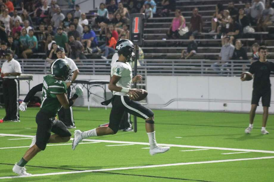 Memorial quarterback Jordan See scampers into the end zone from seven yards out for the team's fourth touchdown of the game and the season Friday night. Photo: Robert Avery