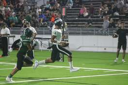 Memorial quarterback Jordan See scampers into the end zone from seven yards out for the team's fourth touchdown of the game and the season Friday night.