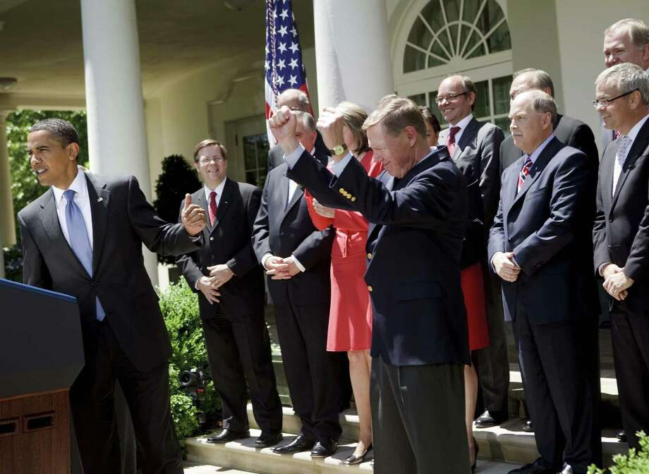 President Barack Obama gestures toward Alan Mulally, then CEO of Ford, at the White House on May 19, 2009. Photo: Bloomberg Photo By Brendan Smialowski / Bloomberg