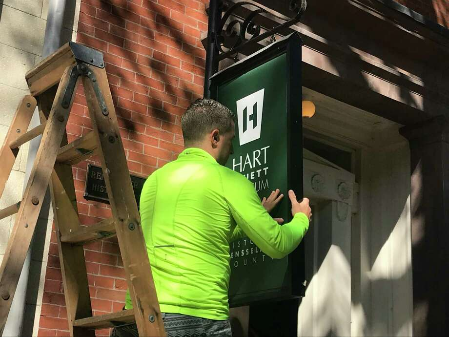 The new sign goes up as Historic Rensselaer County at the Hart Cluett Museum replaces the old Rensselaer County Historical Society name at 57 Second St., Troy New York Photo: Kenneth C. Crowe II/Times Union
