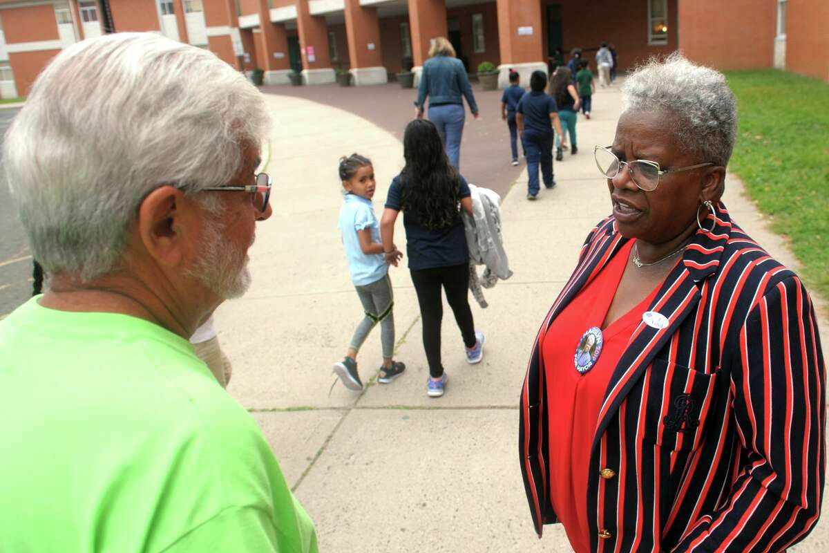 State Sen. Marilyn Moore greets voters turning out for the Sept. 10 primary in front of Luis Munoz Marin School, in Bridgeport. Moore lost the Democratic nomination to incumbant Mayor Joe Ganim after absentee ballots were counted.