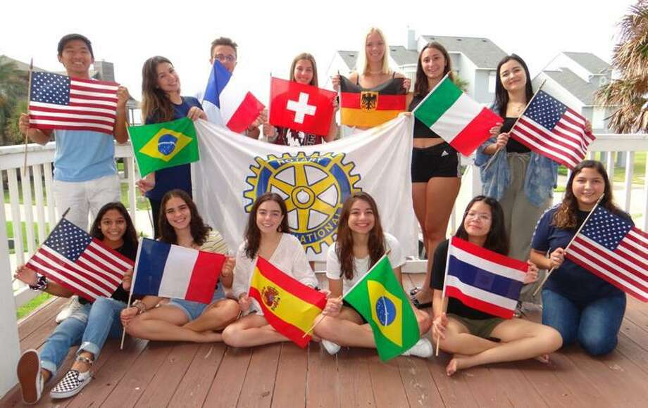 Nine inbound Rotary Youth Exchange students recently spent time on Galveston Island for orientation weekend, hosted by The Rotary District 5910 RYE Committee and The Galveston Rotary Club. The students are from Brazil, France, Germany, Italy, Spain, Switzerland and Thailand and will live with host families in Texas for the 2019/2020 School year. Two of the students are residing in Montgomery County and are hosted by the Rotary Clubs of The Woodlands and Lake Conroe. The four teens pictured with the American flags are students from our District who were outbound RYE students in prior years and helped the RYE Committee with orientation. Photo: Photo By Rotarian PDG Ulli Budelmann