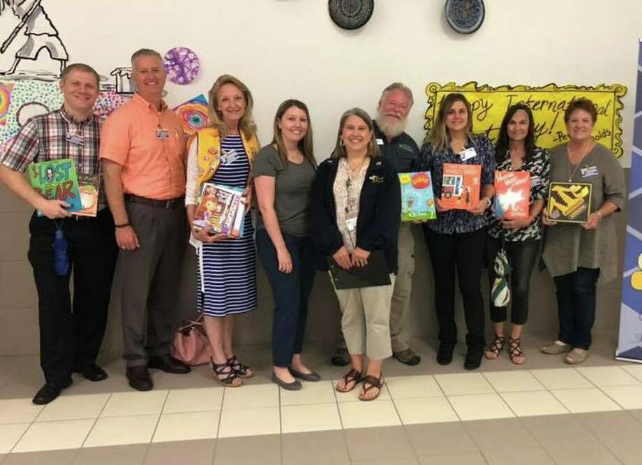 Members of the Conroe Noon Lions Club got involved at their adopted school of Reaves Elementary by providing a Lion to read to each class during their 'Read for Life' event. Pictured: (l-r) Brandon Folts, Rich Sproba, Helen Thornton, Amy Cannon, School Counselor Lisa Durham, Ed Dolphin, Amanda Anders, Jane Copeland, Connie Engle. Photo: Courtesy Photo