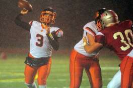 Owen Matthews (shown in a game last season) threw for 399 yards in Ridgefield's 17-14 win over New Canaan.