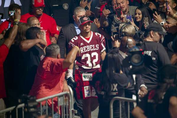 Michael Dutchover, wearing a Lee Rebel tribute shirt to Cedric Benson, enters the ring 09/20/19 night at The Hacienda Event Center. Tim Fischer/Reporter-Telegram
