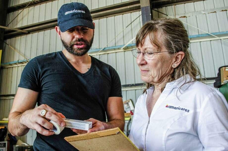 Americares relief workers Aaron Mishlerassist, left, and Lisa LaDue assist Hurricane Dorian evacuees arriving in Nassau on Sept. 7, 2019. Photo: Alex Ostasiewicz /Americares