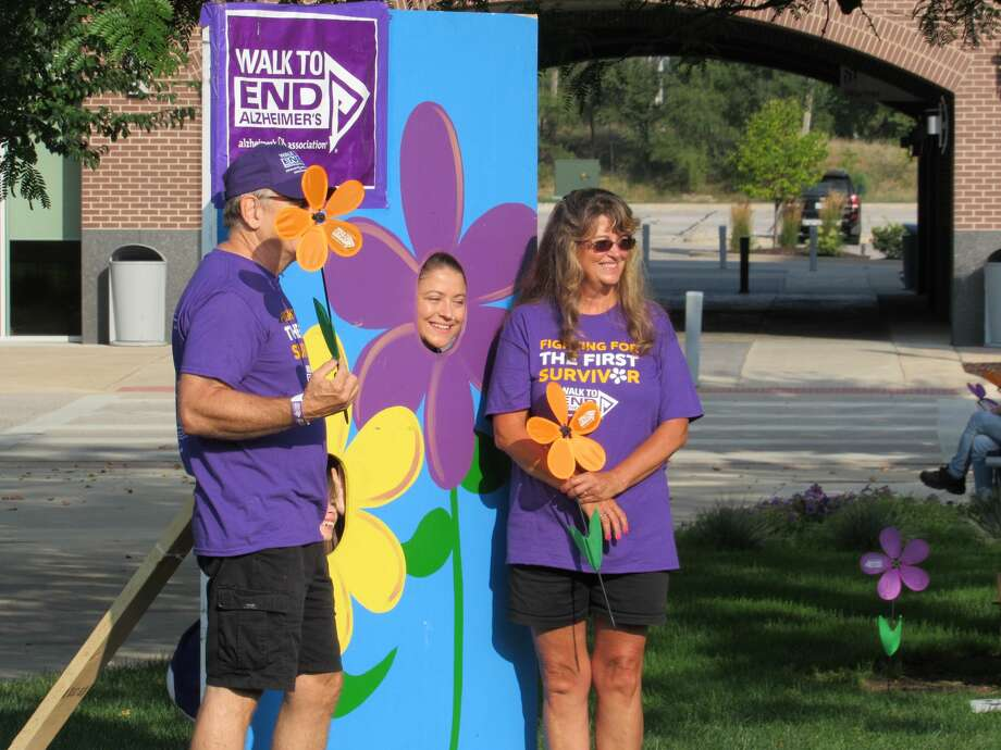 On Saturday, more than 300 people from across Midland County met at Dow Diamond to begin a 2.1-mile walk to raise money and awareness for the fight against Alzheimer's disease. As of this weekend, the local chapter of Alzheimer's Association has raised nearly $61,000 toward its year-end goal of $75,000 for the cause of curing Alzheimer's. (Mitchell Kukulka/Mitchell.Kukulka@mdn.net) Photo: Mitchell Kukulka
