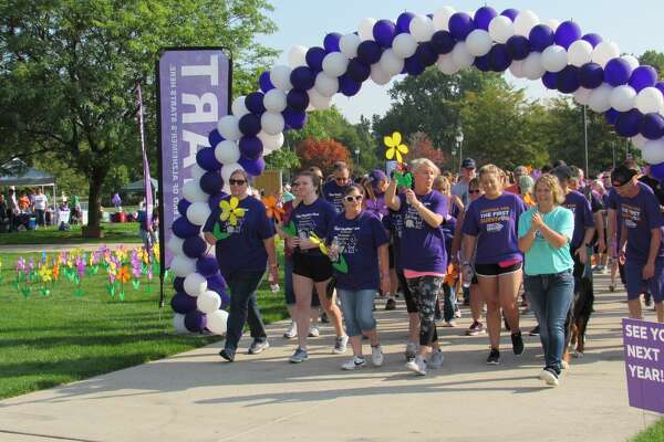 On Saturday, more than 300 people from across Midland County met at Dow Diamond to begin a 2.1-mile walk to raise money and awareness for the fight against Alzheimer's disease. As of this weekend, the local chapter of Alzheimer's Association has raised nearly $61,000 toward its year-end goal of $75,000 for the cause of curing Alzheimer's. (Mitchell Kukulka/Mitchell.Kukulka@mdn.net)