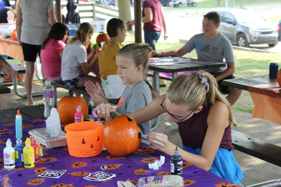 Families started autumn off in Caseville for the annual PumpkinFest. Events all over city included pumpkin decorating, the pumpkin roll, and a classic car show. Photo: Robert Creenan/Huron Daily Tribune