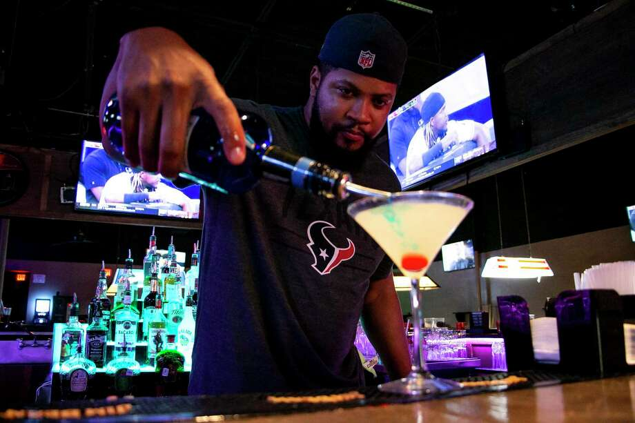 Michael Nelms, the bartender at Stella's Place, focuses on crafting a cocktail. He calls the business a friendly neighborhood bar offering karaoke, pool tables and televisions for watching sports. Photo: By Savannah Mehrtens