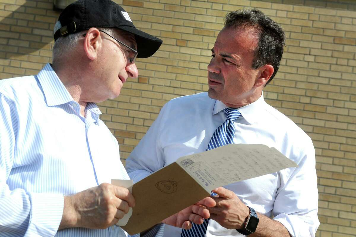 In a 2018 file photo, Bridgeport Mayor Joe Ganim, consulted Mario Testa, chairman of the city's Democratic Town Committee on the day of his failed effort to win the party's gubernatorial primary.