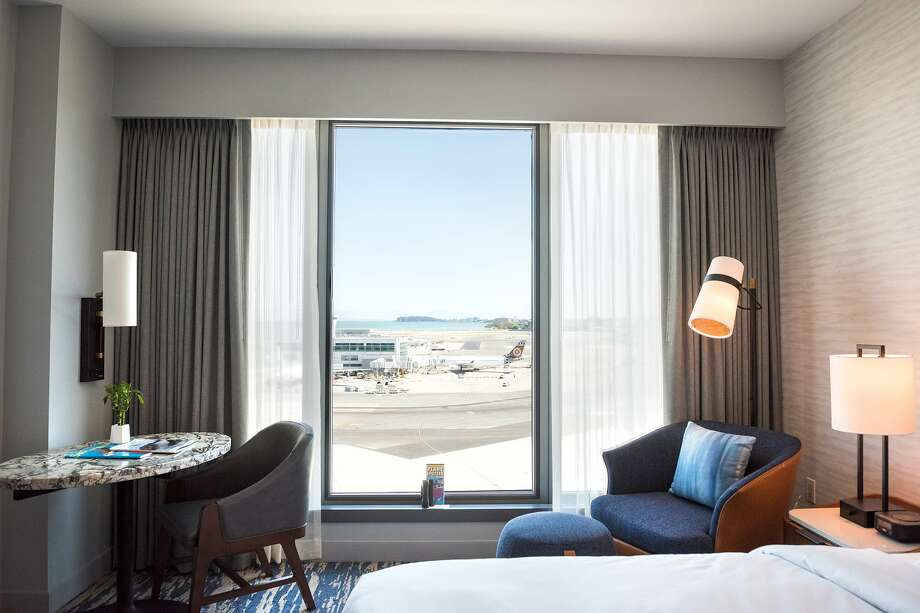 Here's the ramp and runway view from a standard room on the 8th floor at the Grand Hyatt at SFO Photo: Blair Heagerty / SFGate