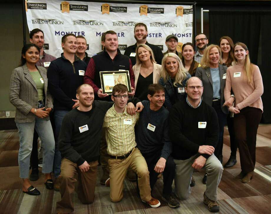 Employees from Tierra Farm stand with their award in the best small companies category during the Annual Top Workplaces event at the Albany Capital Center on Tuesday April 9, 2019 in Albany, N.Y. (Lori Van Buren/Times Union) Photo: Lori Van Buren / 20046647A