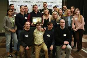 Employees from Tierra Farm stand with their award in the best small companies category during the Annual Top Workplaces event at the Albany Capital Center on Tuesday April 9, 2019 in Albany, N.Y. (Lori Van Buren/Times Union)
