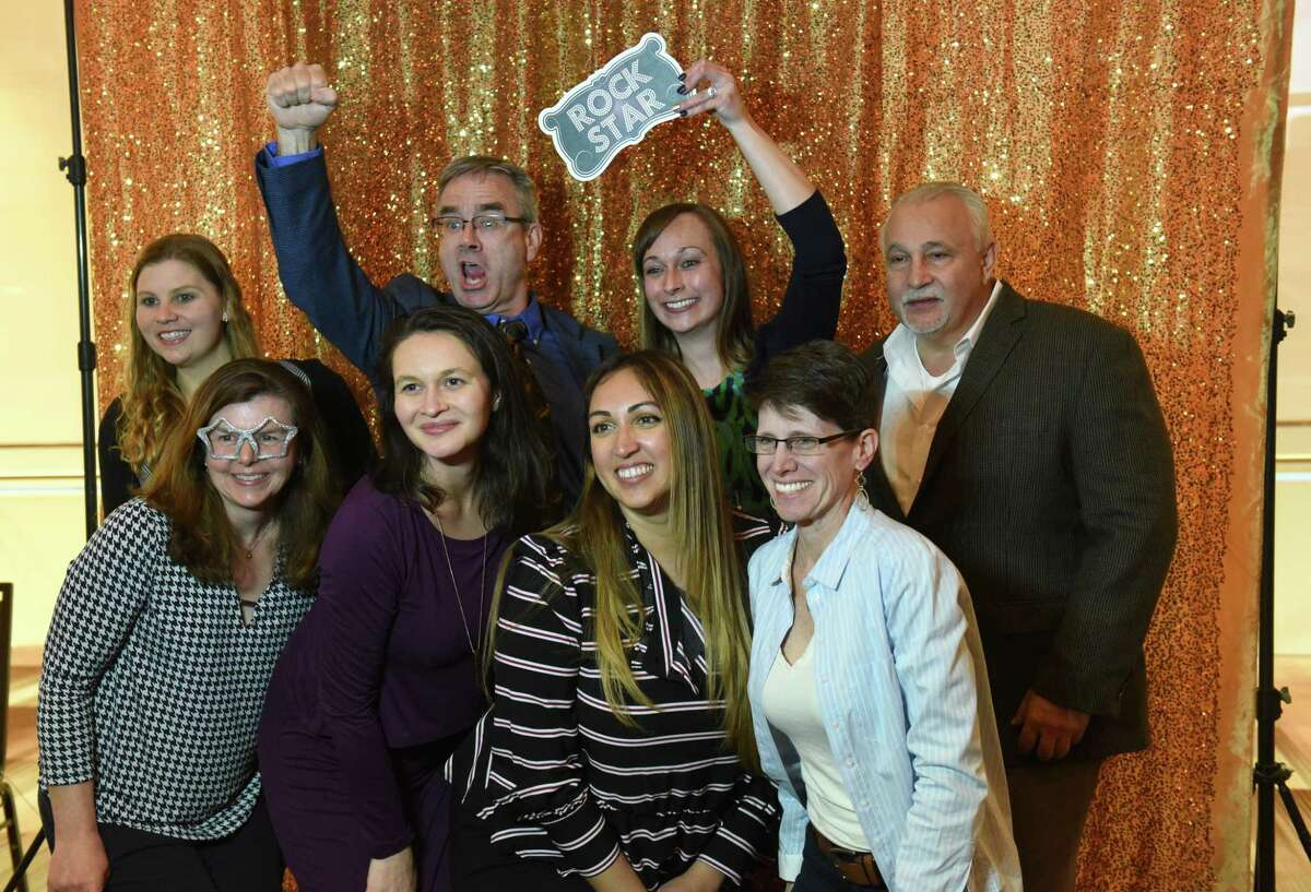 Employees from Chazen Companies have fun at the photo booth set up at the Annual Top Workplaces event at the Albany Capital Center on Tuesday April 9, 2019 in Albany, N.Y. (Lori Van Buren/Times Union)