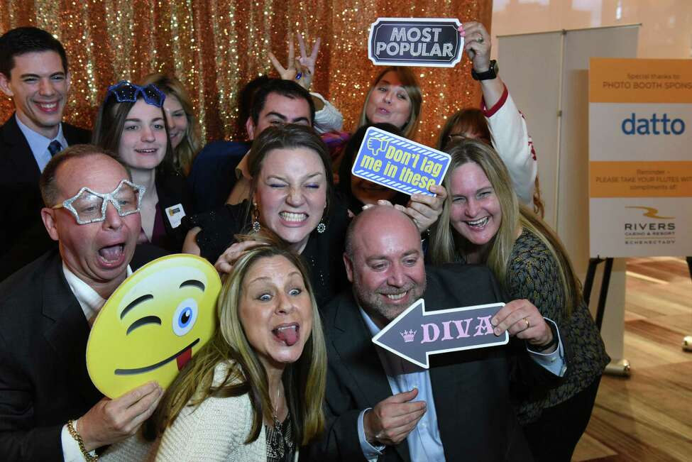 Employees from United Group have fun at the photo booth set up at the Annual Top Workplaces event at the Albany Capital Center on Tuesday April 9, 2019 in Albany, N.Y. (Lori Van Buren/Times Union)