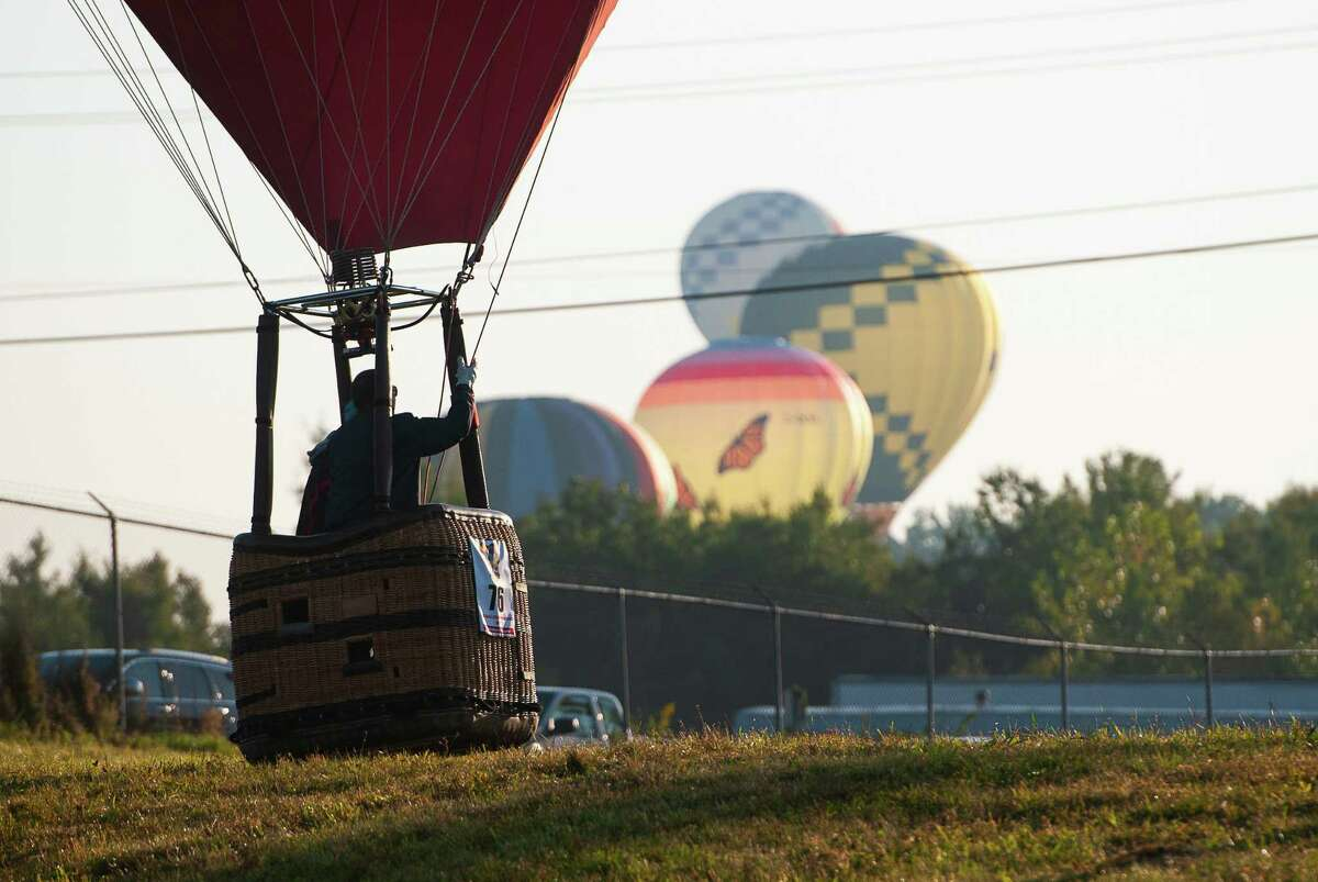 A pilot lands his hot air balloon during the morning launch Saturday, Sept. 21, 2019, of the 47th Annual Adirondack Balloon Festival at Floyd Bennett Memorial Airport in Queensbury, N.Y. (Jenn March, Special to the Times Union)