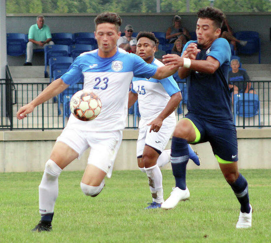 Rodrigo Botello of Heartland, right, is shielded off the ball by LCCC's Will Grant in Region 24 action Saturday at Tim Rooney stadium. LCCC won 4-1. Photo: Pete Hayes | The Telegraph