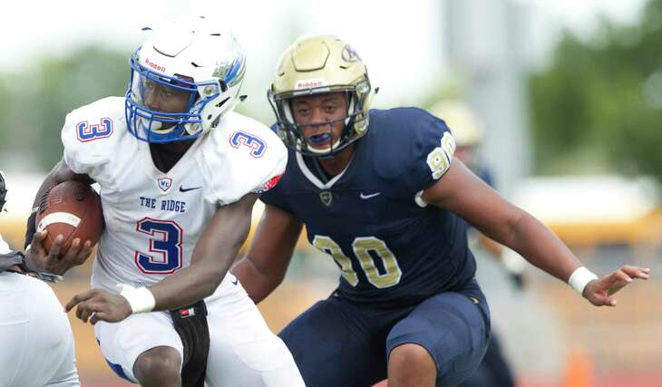 Oak Ridge quarterback Kavon Townsend (3) looks to run as Klein Collins defensive linemen Cornelius Campbell (90) gives pressure during the second quarter of a District 15-6A high school football game at Klein Memorial Stadium, Saturday, Sept. 21, 2019, in Spring.