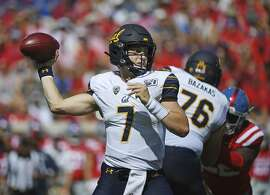 California quarterback Chase Garbers (7) looks to pass during the first half of an NCAA college football game against Mississippi in Oxford, Miss., Saturday, Sept. 21, 2019. (AP Photo/Thomas Graning)