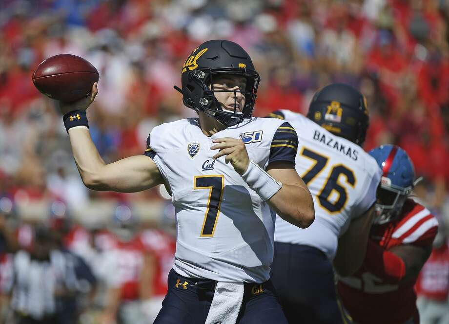 Cal quarterback Chase Garbers threw for four touchdowns and 357 yards passing in Saturday's win at Ole Miss. Photo: Thomas Graning / Associated Press