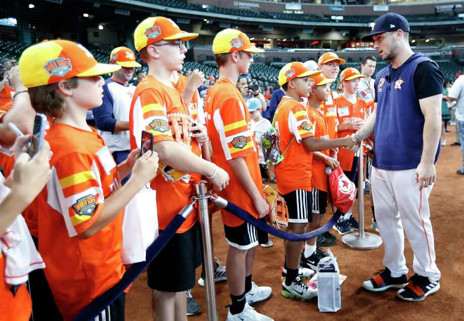 Houston Astros Alex Bregman greets members of the Eastbank Little League from New Orleans, who recently won the Little League World Series during batting practice before the start of an MLB baseball game at Minute Maid Park, Saturday, Sept. 21, 2019, in Houston. Photo: Karen Warren, Staff Photographer / © 2019 Houston Chronicle