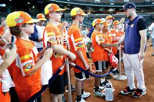 Houston Astros Alex Bregman greets members of the Eastbank Little League from New Orleans, who recently won the Little League World Series during batting practice before the start of an MLB baseball game at Minute Maid Park, Saturday, Sept. 21, 2019, in Houston.