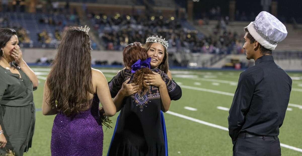 Homecoming queen Sativa Santisteven hugs Midland High School principal Leslie Sparacello on Friday, Sept. 20, 2019 at Grande Communications Stadium.