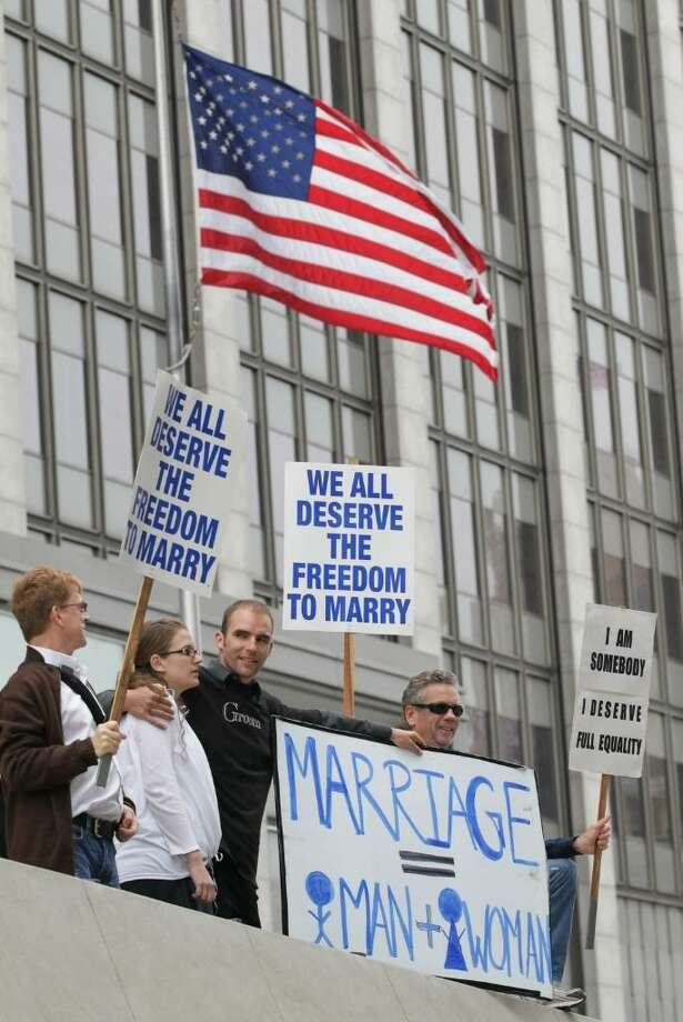 SAN FRANCISCO - AUGUST 04:  Prop 8 supporters Nadia Chayka (2-L) and her fiance Luke Otterstad (3-L) stand in between Prop 8 opponents Billy Radford (R) and Ron Weaver (L) as they stand outside of the Philip Burton Federal building August 4, 2010 in San Francisco, California. US District Judge Vaughn Walker will announce his ruling today on the constitutionality of Prop 8 in California, a voter approved measure that denies same-sex couples the right to marry in the State of California.  (Photo by Justin Sullivan/Getty Images) *** Local Caption *** Nadia Chayka;Luke Otterstad;Ron Weaver;Billy Radford Photo: Justin Sullivan, Getty Images / 2010 Getty Images