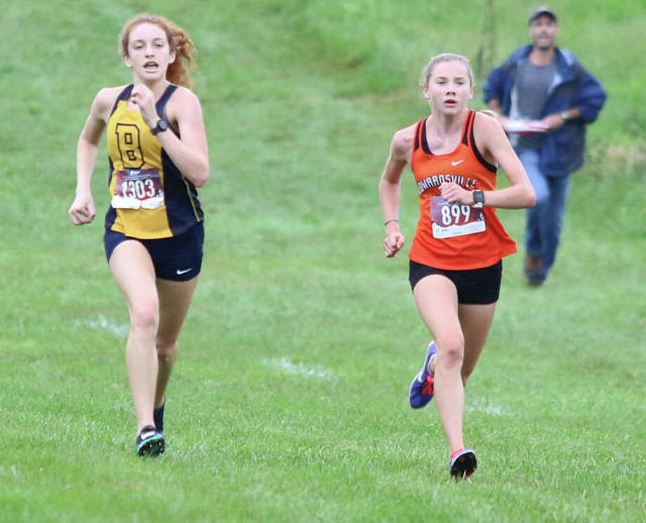 Edwardsville freshman Riley Knoyle (right) fights off John Burroughs junior Kylie Goldfarb in the race's final 100 meters to win the 54th Edwardsville Invitational girls cross country race Saturday morning at SIUE in Edwardsville. Knoyle won in 18:56.06, with Goldfarb second in 18:57.88. Photo: Greg Shashack / The Telegraph