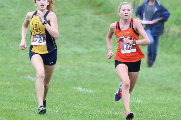 Edwardsville freshman Riley Knoyle (right) fights off John Burroughs junior Kylie Goldfarb in the race's final 100 meters to win the 54th Edwardsville Invitational girls cross country race Saturday morning at SIUE in Edwardsville. Knoyle won in 18:56.06, with Goldfarb second in 18:57.88.