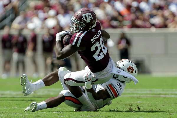 Texas A&M Aggies running back Isaiah Spiller (28) is tackled by Auburn Tigers linebacker Zakoby McClain (35) during the first quarter of an SEC game at Kyle Field Saturday, Sept. 21, 2019, in College Station, TX.