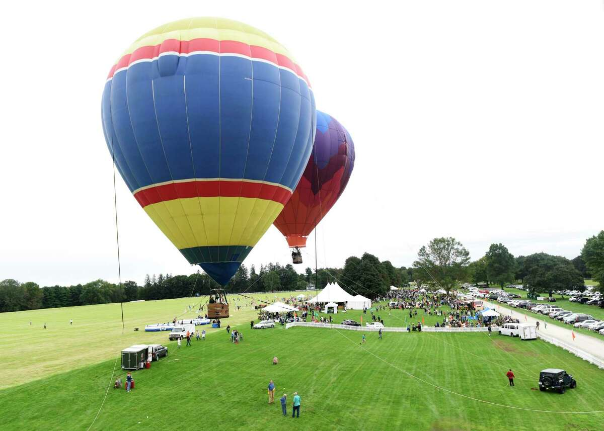 """The Greenwich Land Trust will """"Go Wild"""" as it celebrates its 20th anniversary from 3 to 6 p.m. Sundayat the Greenwich Polo Club, 1 Hurlingham Drive. It will include food trucks, exciting activities and hot air balloon rides, bungee trampolines, arts and crafts, animal encounters, and more. Everything is included in the price of a ticket. For tickets ($70 and adults, $30 for kids) or more information, visit gltrust.org/events/gowild/."""