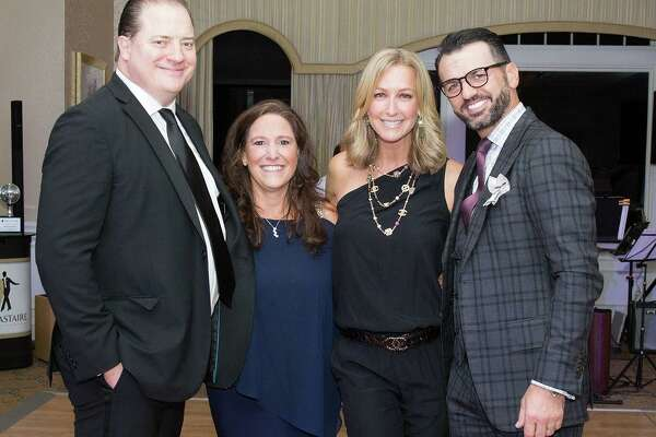 "'Dancing Stars of Greenwich' celebrity judges pose with Abilis CEO and president. From left: actor Brendan Fraser; Amy Montimurro, CEO and president of Abilis; TV host Lara Spencer and Tony Dovolani, a champion from ""Dancing With the Stars."" The fundraiser for Abilis was held at the Tamarack Country Club."