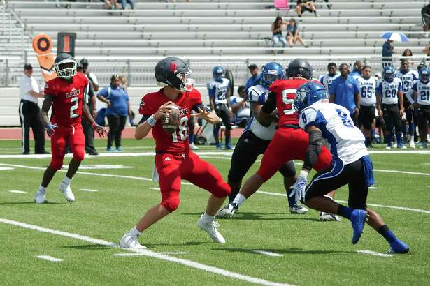 Clear Lake quarterback Donovan Sweeney (18) sets up to pass against Chavez Saturday at Challenger Columbia Stadium.