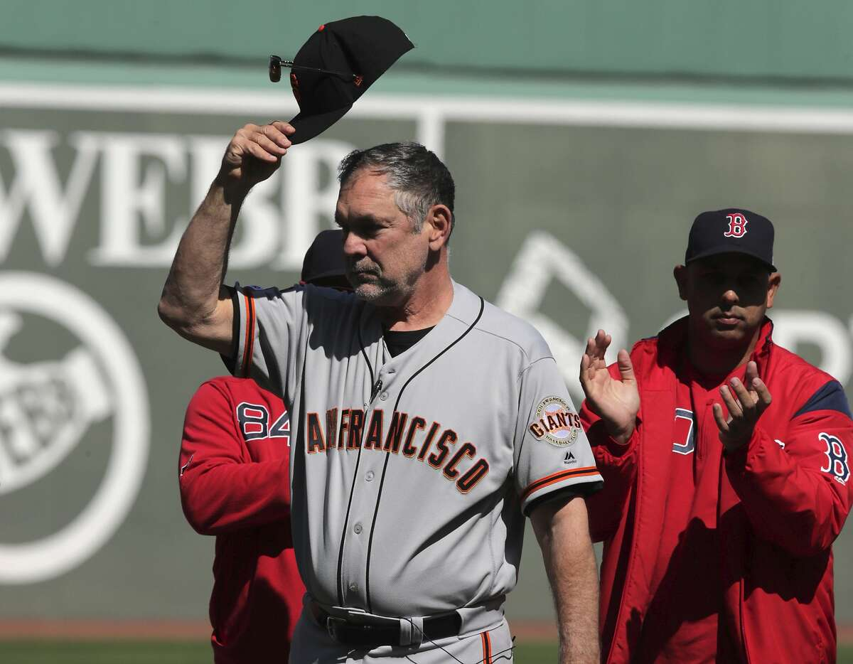 San Francisco Giants manager Bruce Bochy tips his cap as he is honored prior to a baseball game against the Boston Red Sox at Fenway Park in Boston, Thursday, Sept. 19, 2019. (AP Photo/Charles Krupa)