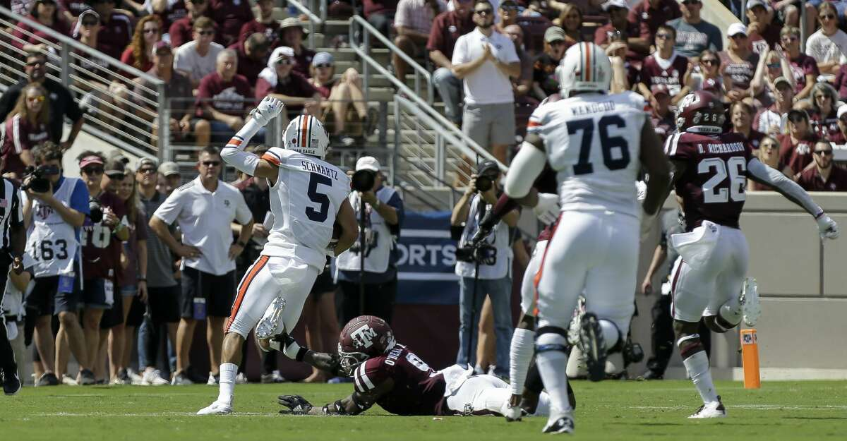 Auburn Tigers wide receiver Anthony Schwartz (5) on his way to a 57-yard touchdown run against the Texas A&M Aggies during the first quarter of an SEC game at Kyle Field Saturday, Sept. 21, 2019, in College Station, TX.
