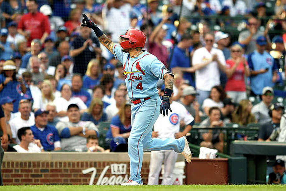 The Cardinals' Yadier Molina celebrates while rounding the bases after hitting a solo home run in the ninth inning of Saturday's win over the Cubs in Chicago. Photo: AP Photo