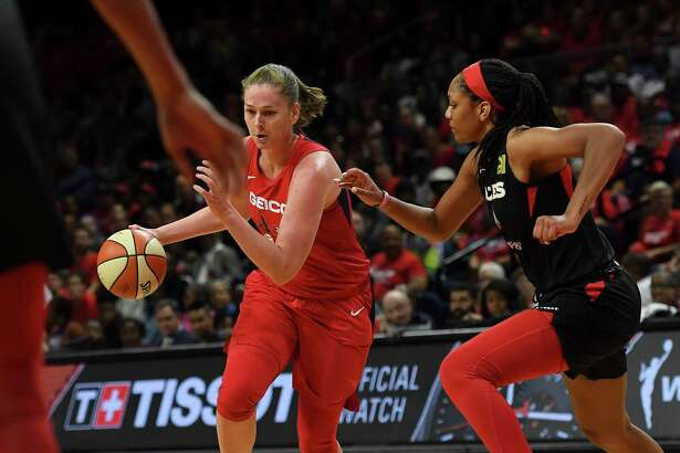 Mystics center Emma Meesseman drives with past Aces center A'ja Wilson, right, during the first half of Game 2 in their WNBA playoff series. Meesseman took the 2018 season off and has responded in a big way in her return to the court.