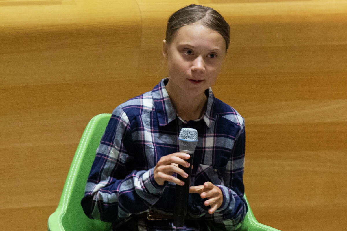 Swedish environmental activist Greta Thunberg, speaks to guests during the Youth Climate Summit at United Nations headquarters, Saturday, Sept. 21, 2019. A (AP Photo/Eduardo Munoz Alvarez)