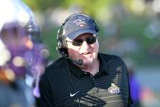 University at Albany head coach Greg Gattuso instructs his players against Lafayette during the first half of an NCAA college football game Saturday, Sept. 21, 2019, in Albany, N.Y.