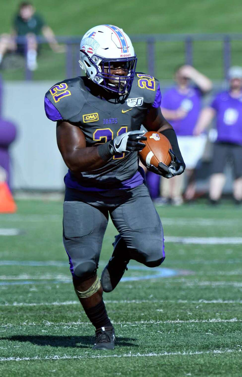 University at Albany running back Karl Mofor (21) scores a touchdown against Lafayette during the first half of an NCAA college football game Saturday, Sept. 21, 2019, in Albany, N.Y.