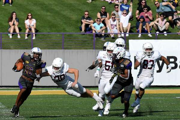 University at Albany wide receiver Donovan McDonald (10) returns the opening kickoff back for a touchdown against Lafayette during the first half of an NCAA college football game Saturday, Sept. 21, 2019, in Albany, N.Y.