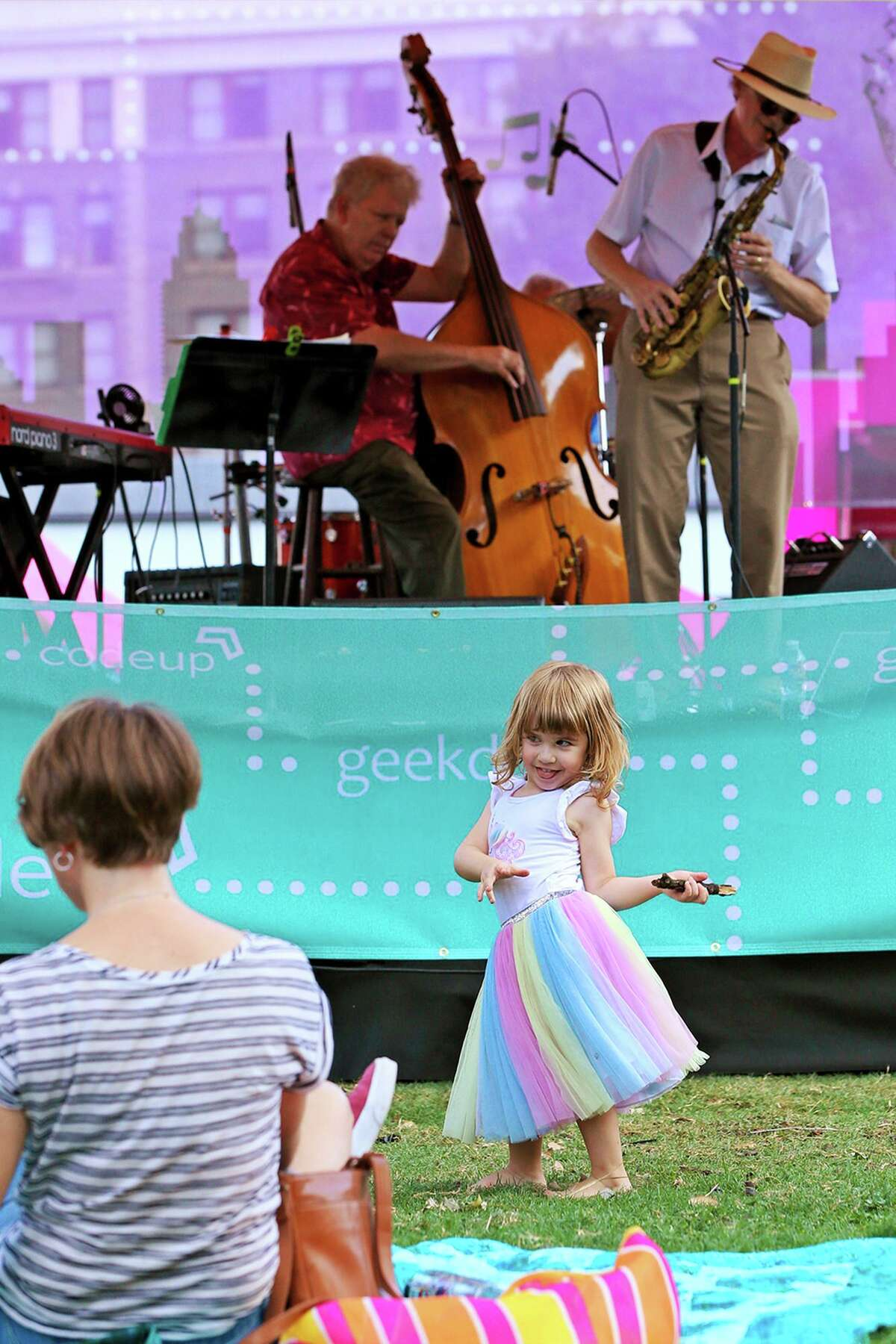 Hazel Young Hess, 3, dances in front of the Tech Tempo stage, where her grandfather, Mark Hess, plays piano with the Hess Brothers at the 36th Annual Jazz'SAlive festival at Travis Park on Saturday, Sept. 21, 2019. This year's festival featured five-time Grammy winner Diane Reeves and local acts including The Lao Tizer Band, The U.S. Air Force Band dimensions in Blue and the Adrian Ruiz Quartet