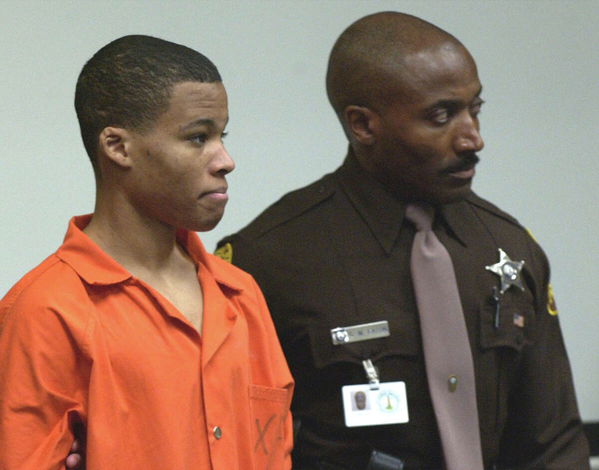 **FILE** Sniper suspect Lee Boyd Malvo, left, is brought into court to be identified by a witness during the trial of sniper suspect John Allen Muhammad at the Virginia Beach Circuit Court in Virginia Beach, Va.,Wednesday Oct. 22, 2003. Jury selection begins today, Monday, Nov. 10, 2003, in the trial of Malvo, in Chesapeake, Va. (AP Photo/Davis Turner,pool)